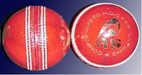 [Graphic: The cricket ball with seam]